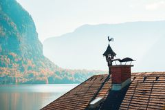 Vintage weathercock on the roof in Hallstatt, Austria. Autumn landscape royalty free stock image