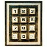 Vintage weathered keypad with reset buttons. Vintage weathered keypad with reset and number buttons Stock Photography