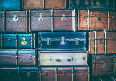 Vintage weathered leather suitcases on top of each other Stock Photo