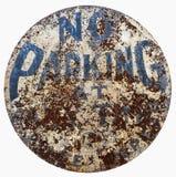 Vintage Weathered NO PARKING Sign. Vintage weathered circular NO PARKING sign. Isolated stock photo