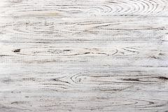 Vintage weathered shabby white painted wood texture as background.  royalty free stock images