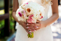 Vintage wedding bouquet in hands stock photography