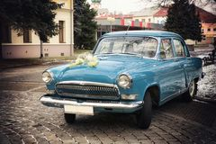 Vintage Wedding Car Decorated with Flowers. Vintage Wedding Car (the old Russian brand  GAZ Volga Royalty Free Stock Photo