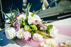 Vintage Wedding Car Decorated with Flowers Stock Images