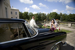 Vintage Wedding Car Flowers bride with groom Stock Photos