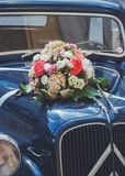 Vintage wedding car with flowers Royalty Free Stock Photo