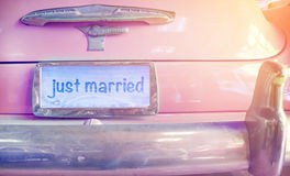 Vintage wedding car with just married sign. Serenity and rose quartz color filter Stock Photography
