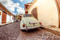 Vintage wedding car waiting at village street Royalty Free Stock Photography