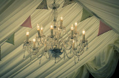 A vintage wedding chandelier and bunting Royalty Free Stock Photo
