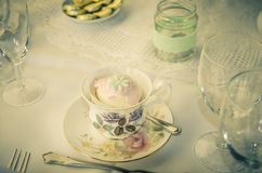 A vintage wedding cup cake in teacup Royalty Free Stock Image