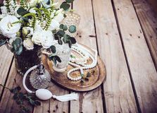 Vintage wedding decor, perfume and pearl beads, flower bouquet Royalty Free Stock Photography