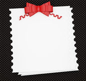 Vintage wedding paper background with red bow. Stock Photo