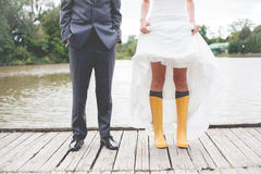 Vintage Wedding. On a rainy day with yellow rain boots Stock Image