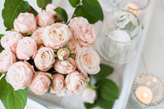 Vintage wedding table decorations with roses, candles  cutlery Stock Images