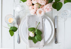 Vintage wedding table decorations with roses, candles  cutlery Stock Photo
