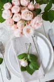 Vintage wedding table decorations with roses, candles  cutlery Stock Photography