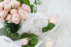 Vintage wedding table decorations with roses, candles  cutlery Stock Photos