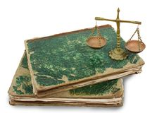 Vintage weighing instrument and old  books Stock Image