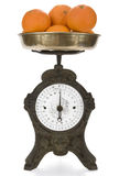 Vintage weight scale with oranges royalty free stock photos