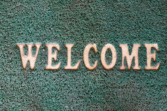 Vintage welcome. Sign on green background Royalty Free Stock Image