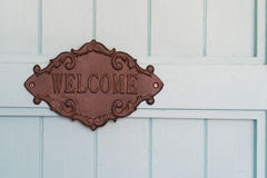 Vintage Welcome sign of the coffee shop on the blue wood door background Stock Image