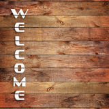 Vintage WELCOME sign on natural wooden surface. Closeup Stock Photography