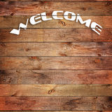 Vintage WELCOME sign on natural wooden surface. Closeup Stock Photos