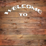 Vintage WELCOME TO sign on natural wooden surface. Closeup Stock Photography