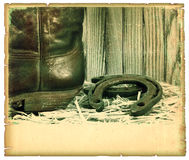 Vintage western background with cowboy shoe. And horseshoe Royalty Free Stock Images