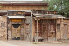 Vintage western saloon mud brick shack front door. Historic saloon boarded up front door mud brick shack facade of vintage building near Tucson, Arizona, AZ, USA Stock Photos