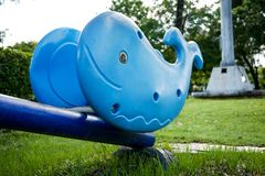 Whale Seesaw Toy in the park. Vintage Whale Seesaw Toy in the park Royalty Free Stock Photography