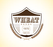 Vintage wheat badge design template. vector stock. Royalty Free Stock Photo