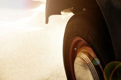 Vintage wheel of classic car, shiny car body, selective focus royalty free stock image