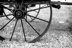 Vintage Wheel. Old vintage wheel and wagon resting on the side of the road royalty free stock photo