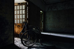 Vintage Wheelchair in Hallway - Abandoned Hospital / Sanitarium - New York. An interior view of a vintage wheelchair in a hallway inside an abandoned hospital in stock image