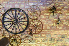 Vintage wheels various carts on the background of a stone wall Stock Images