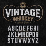 Vintage whiskey label font with sample design. Ideal for any design in vintage style Royalty Free Stock Photography