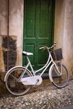 Vintage White Bicycle Bike against Green Door in Italy. A vintage white bike against a green doorway in a town of the Cinque Terre, Italy Royalty Free Stock Photography