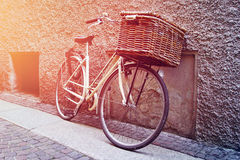 Vintage white bicycle with wicker brown basket Royalty Free Stock Image