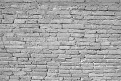 Vintage white brick wall with cracked concrete Royalty Free Stock Photography