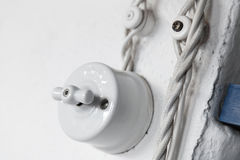 Vintage white ceramic electric switch Stock Photography