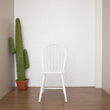 Vintage white chair. On wooden floor Stock Image