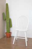 Vintage white chair. On wooden floor Stock Photography