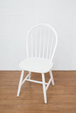 Vintage white chair. On wooden floor Royalty Free Stock Photo
