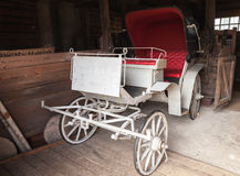 Vintage white coach with red saloon Royalty Free Stock Image