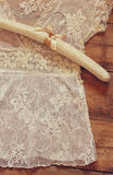 Vintage white crochet lace top with hanger on wooden background Stock Image