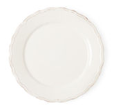 Vintage white empty plate on white background. Vintage white empty plate on a white background royalty free stock image