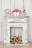 Vintage white fireplace with firewood royalty free stock images