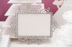 Vintage white frame on a table and place for text.  Stock Images