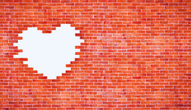 Vintage white heart shape on brick wall style and copyspace. Use for love and Royalty Free Stock Photos